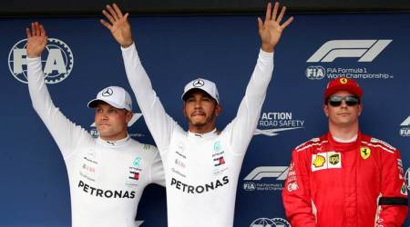 Lewis Hamilton beats the elements to seize pole in wet Hungary