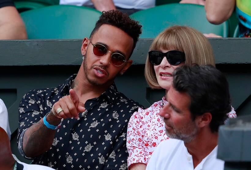 Lewis Hamilton and Anna Wintour sit in the player's box of Serena Williams during the women's singles final match between Serena Williams of the US and Angelique Kerber of Germany at the Wimbledon Tennis Championships