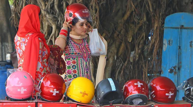 Sikh women wearing helmets, Sikh women exempted, turban wearing Sikh women exempted, helmet rules for Sikh women, helmet rules in chandigarh, sikh women in chandigarh, women on two wheelers, road safety rules, Chandigarh news, road safety news, Indian express news