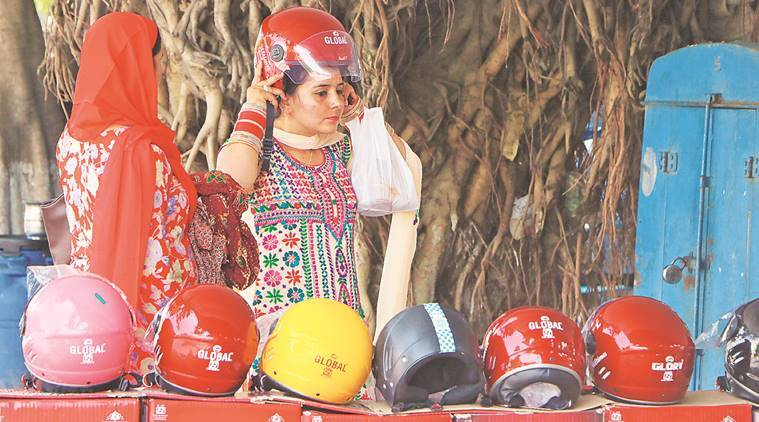 Chandigarh women wearing helmet as per new law