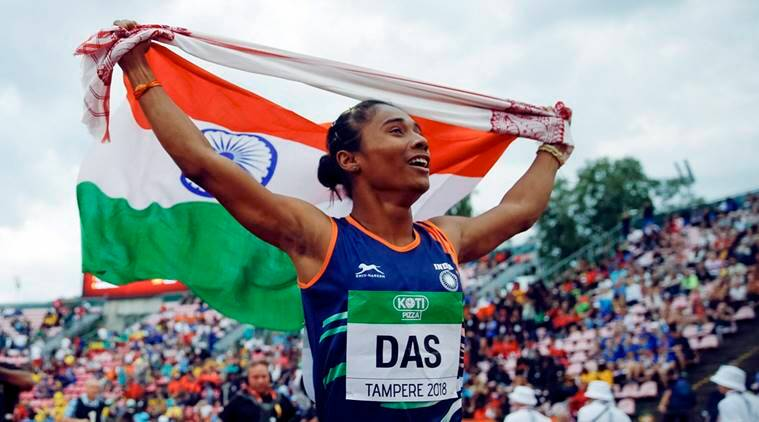 Hima Das, of India, celebrates her victory in women's 400 meter race at the 2018 IAAF World U20 Championships in Tampere, Finland