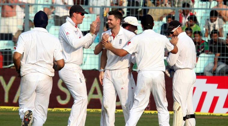 Englands bowler James Anderson celebrates with teammates after taking the wicket of R Ashwin on day one of the third Test match against England in Kolkata on Wednesday