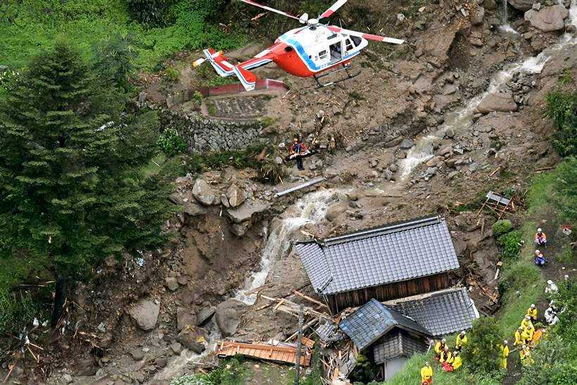 Flooding and landslides in Japan leave at least 100 dead