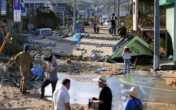 Flooding, landslides kill at least 100 in Japan