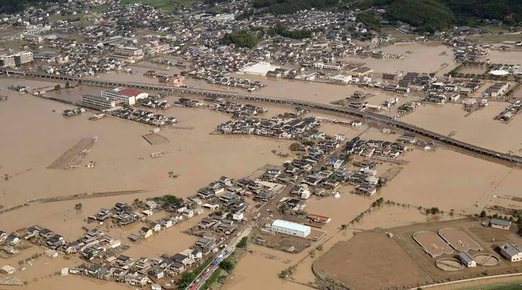 Japan flood leaves 122 dead, rescuers look through mud for ...