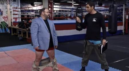 Screengrab from episode showing Jason Spencer (left) with Sacha Baron Cohen (right)