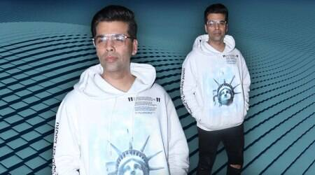 Karan Johar's statement sweatshirt is a good way to add some oomph to a basic outfit