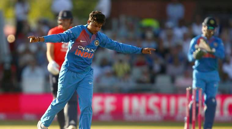 India's Kuldeep Yadav celebrates taking the wicket of England's Jos Buttler during the Twenty20 cricket match between England and India at Old Trafford cricket ground in Manchester