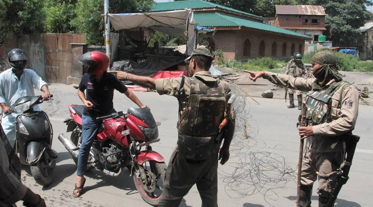 Security personnel on duty in Kulgam district of Jammu and Kashmir on Saturday. (Express photo/Shuaib Masoodi)