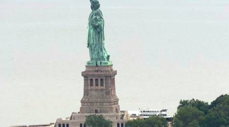 Protester scales Statue of Liberty's base, forces evacuation