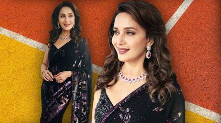 Madhuri Dixit shows us how to exude elegance in a black sari