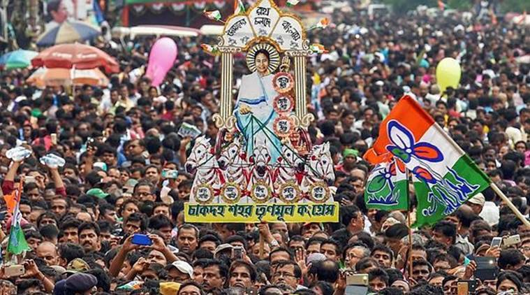 Trinamool Congress workers display a cut out of West Bengal Chief Minister Mamata Banerjee during the annual rally in Kolkata on Saturday. (PTI photo)