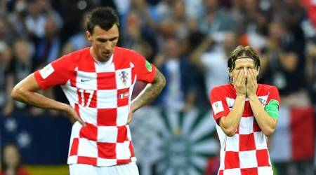 Croatia's Luka Modric and Mario Mandzukic react