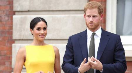 Meghan Markle ditches her pastel shaded outfits; keeps it classy in a yellow dress