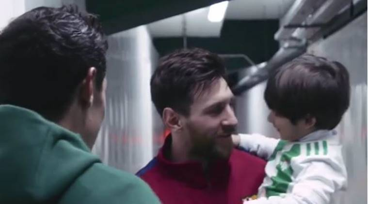 Lionel Messi with Real Betis player Andres Guardado's son.