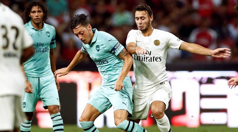 Ozil shines on return as Arsenal crush PSG in Singapore