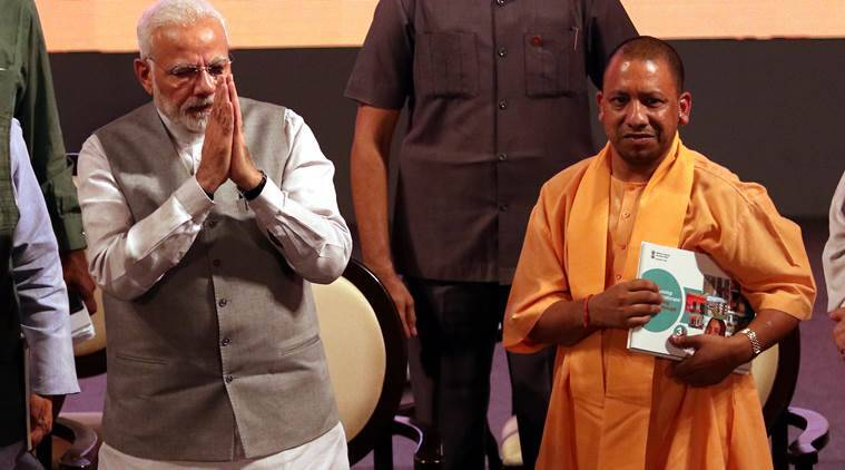 Prime Minister Narendra Modi with Uttar Pradesh Chief Minister Yogi Adityanath at the event in Lucknow on Saturday. (Express photo/Vishal Srivastav)