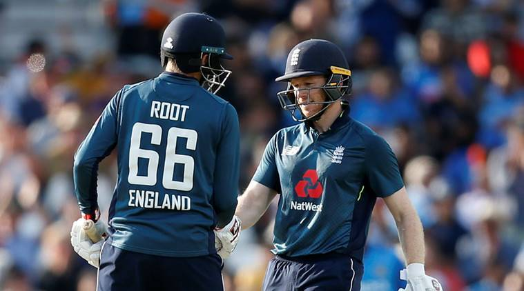 England's Eoin Morgan celebrates after reaching a half century with Joe Root in 3rd ODI against India