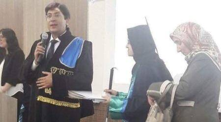 Turkish university awards honorary law degree to mother of visually-challenged student along with her