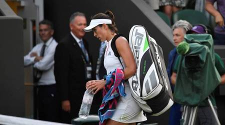 Spain's Garbine Muguruza walks off court after loosing her seccond round match to Belgium's Alison Van Uytvanck.