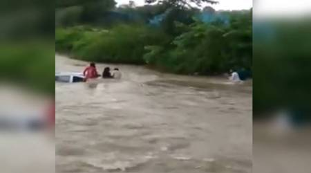 Watch: Locals save family stuck in submerged car near Mumbai
