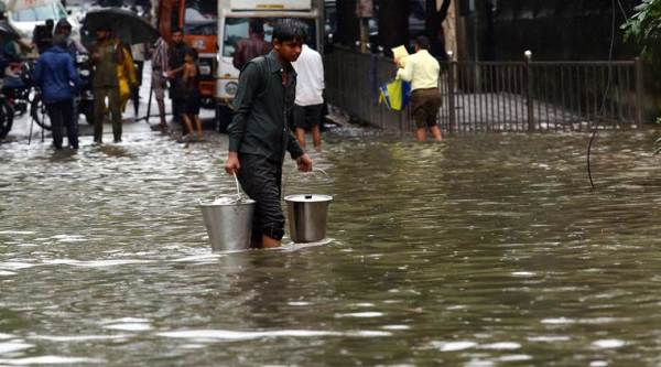 Mumbai Rain weather flooding trains local status flights