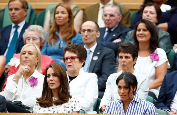 Britain's Catherine the Duchess of Cambridge and Meghan the Duchess of Sussex sit in front of Martina Navratilova and Billie Jean King at Wimbledon