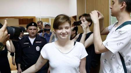 One of four intruders affiliated to anti-Kremlin punk band Pussy Riot, Olga Pakhtusova, who ran onto the pitch during the World Cup final between France and Croatia, is escorted inside a court building in Moscow