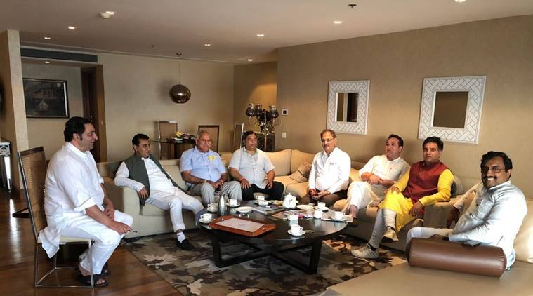 Ram Madhav with BJP leaders and Sajjad Lone