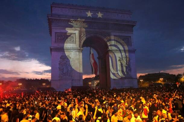 A rooster, a symbol of France, and two stars indicating two World Cup wins, are projected onto the Arc de Triomphe after France won the soccer World Cup final match between France and Croatia