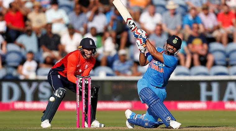 India's Suresh Raina in action as England's Jos Buttler looks on