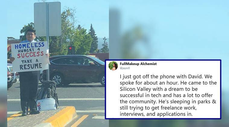 homeless man in silicon valley hands out resumes at traffic signal