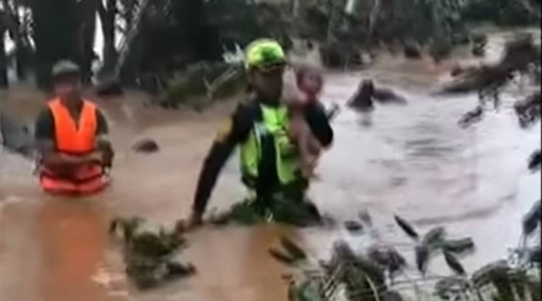 baby saved Laos dam disaster, toddler saved Thai rescue team, thai rescue operation, Thai cave rescue volunteers save baby, viral video,