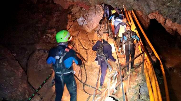 Fighting time, high waters, divers prepare to rescue second group of Thai boys from cave