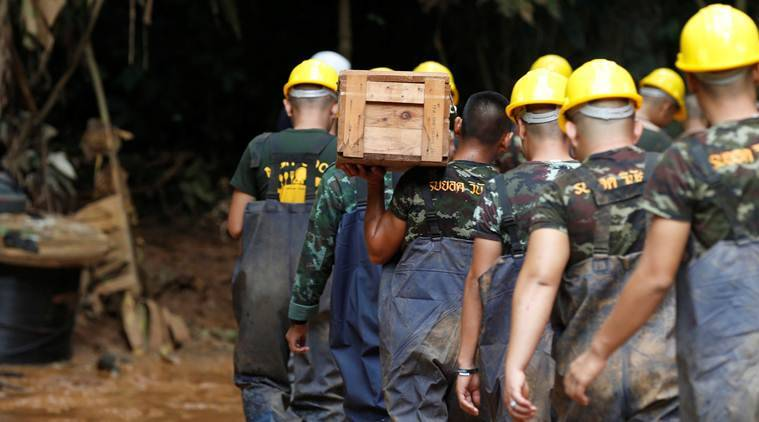 Rescuers ponder how to extract trapped team from flooded Thai cave