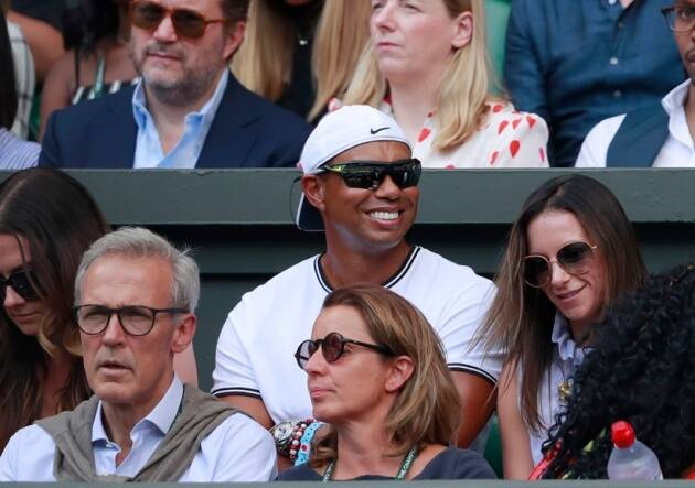 Tiger Woods sits in the player's box of Serena Williams during the women's singles final match between Serena Williams of the US and Angelique Kerber of Germany at the Wimbledon Tennis Championships