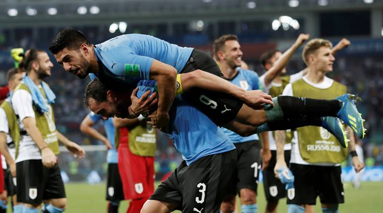Uruguay's Diego Godin and Luis Suarez celebrate after the match against Portugal