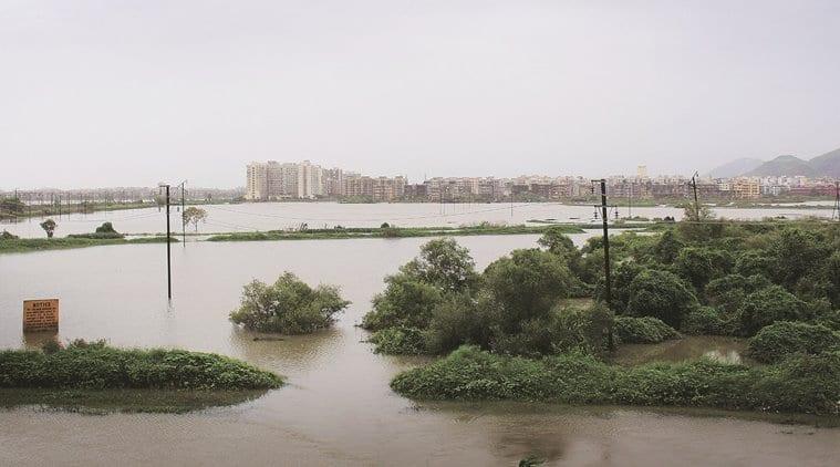 Vasai virar civic body demolishes embankment says it