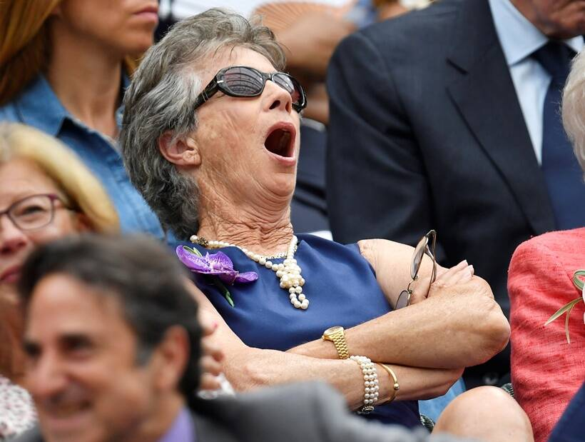 Virginia Wade yawns as she watches Serbia's Novak Djokovic play his semi final match against Spain's Rafael Nadal