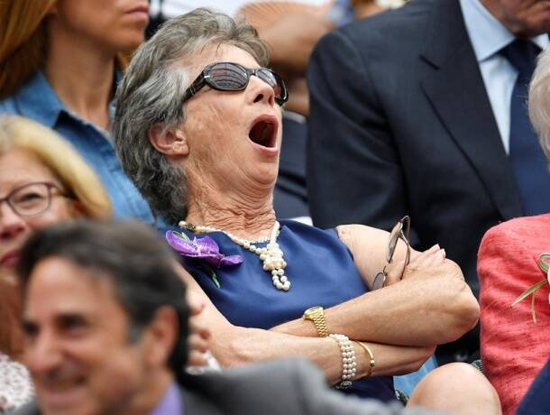 Virginia Wade yawns as she watches Serbia's Novak Djokovic play his semi final match against Spain's Rafael Nadal