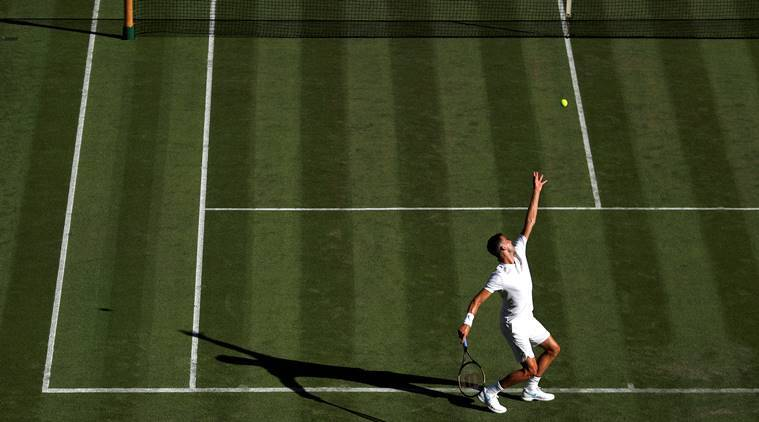 Federer breezes past Lajovic in Wimbledon opener