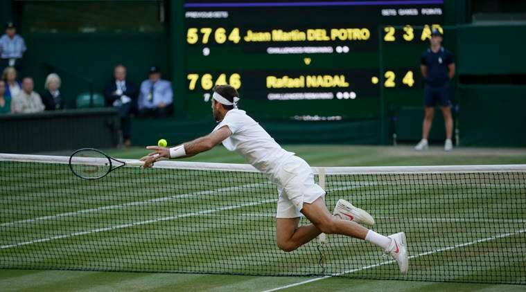 Juan Martin Del Potro of Argentina leaps for a ball during the men's quarterfinal match against Rafael Nadal of Spain at the Wimbledon Tennis Championships in London