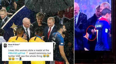 VIDEO: Netizens think this woman tried to steal a World Cup gold medal 'right under Putin's nose'