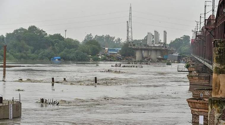 A view of Yamuna river in New Delhi on Saturday. The water level in Yamuna river increased after five lakh cusec water was released from Hathnikund Barrage in Haryana. (PTI)