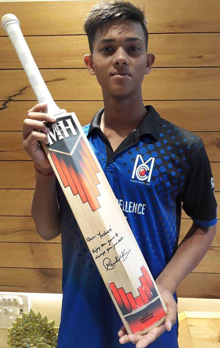 Mumbai cricketer Yashasvi Jaiswal with a bat gifted by Sachin Tendulkar