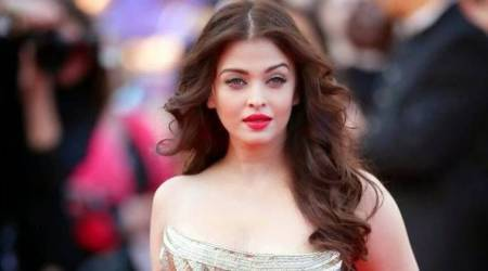 Aishwarya Rai Bachchan's look on this magazine cover is proof that candy stripes will always rule the world