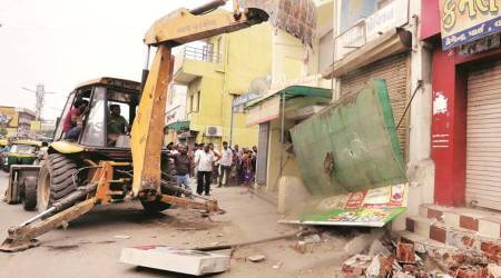 AMC demolishes illegal structures near NH8