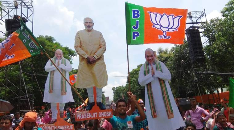 BJP supporters with cutouts of Prime Minister Narendra Modi and Amit Shah at the rally in Kolkata. (Express photo/Partha Paul)
