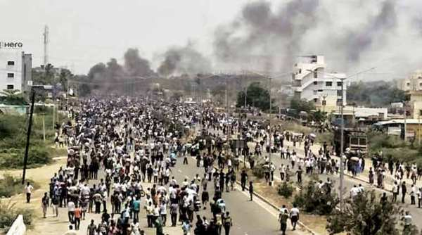 Smoke rises from vehicles set on fire during protests in Tuticorin. (Express Photo/File)