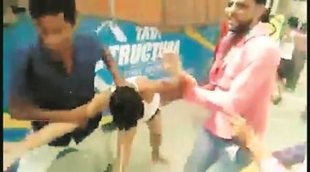 Videograb of the assault. Twelve people have been booked.